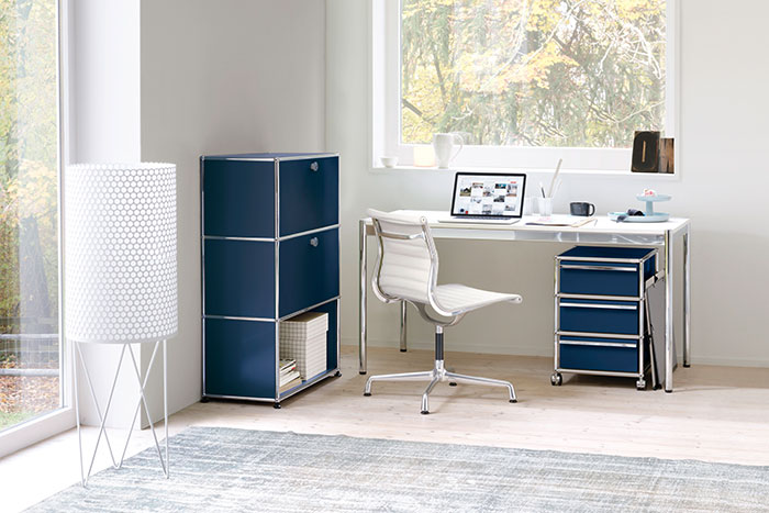 CHAPLINS Haller Storage System And Desk By USM And Eames Aluminium Chair EA 105 By Vitra.