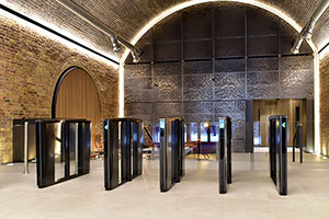 The River Building Secures Lobby with  Boon Edam Optical Turnstiles